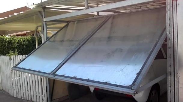 Как сделать подъемно-поворотные гаражные ворота своими руками